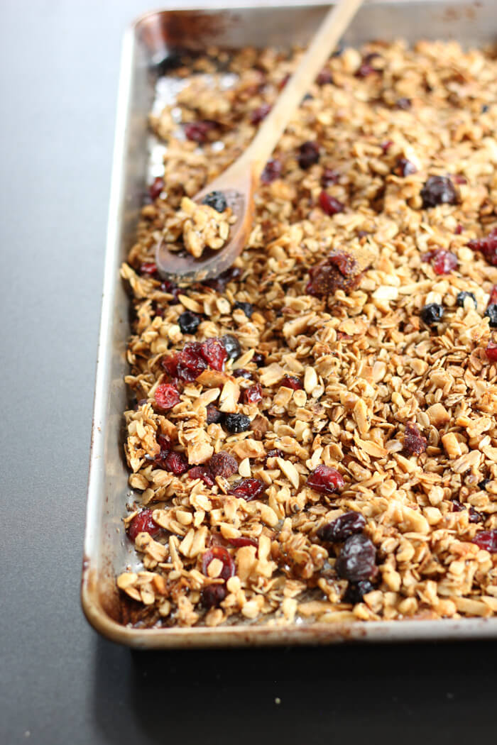 Tasty Everything Granola fresh out of the oven on a baking sheet.