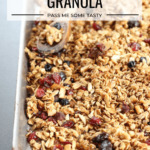 A baking sheet loaded with freshly baked tasty everything granola.
