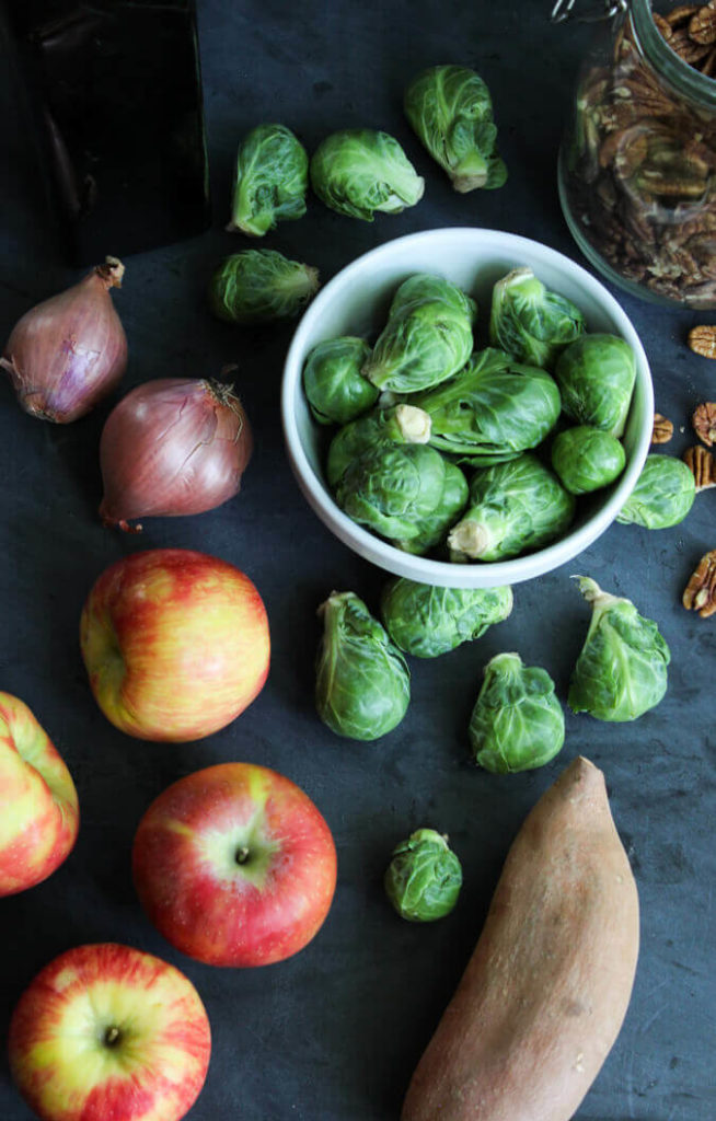 Sweet & Savory Pan Roasted Brussels Sprouts - a quick and easy dish! Contains sweet potatoes, shallots, Honeycrisp apples, pecans and Italian sausage. Yum! | passmesometasty.com