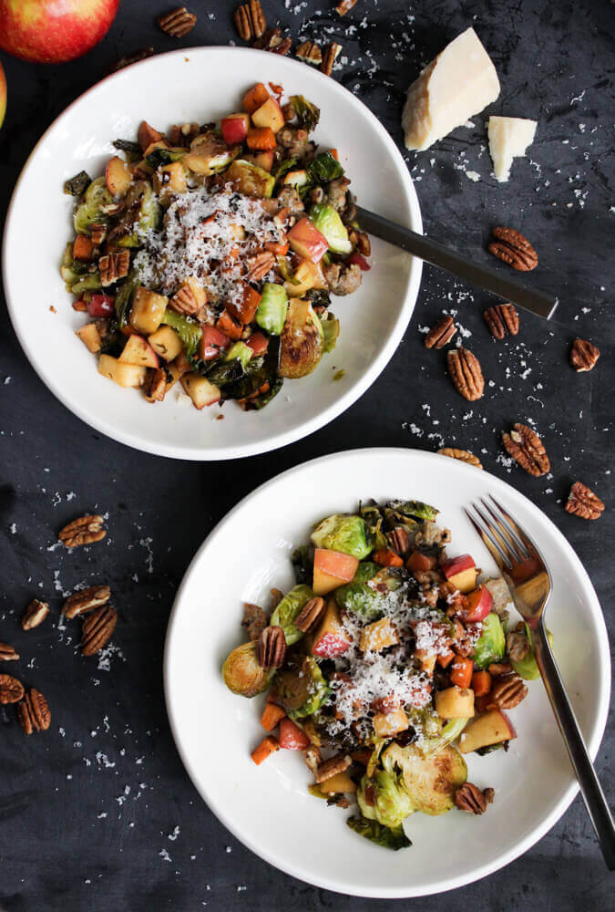 Two plates of Sweet & Savory Pan Roasted Brussels Sprouts served on white dishes.