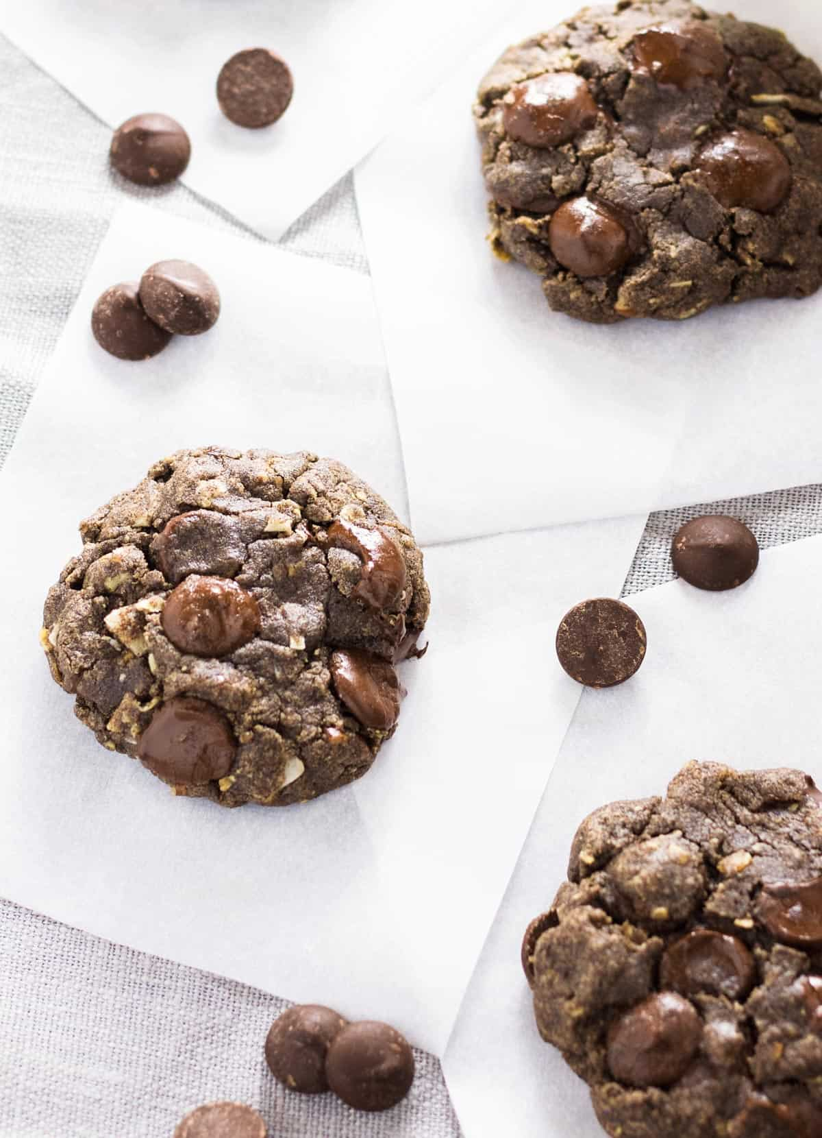 Three cookies set parchment squares.