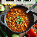 A pot of tasty game day chili loaded with pinto beans, black beans, red peppers, butternut squash, onions, and beef.