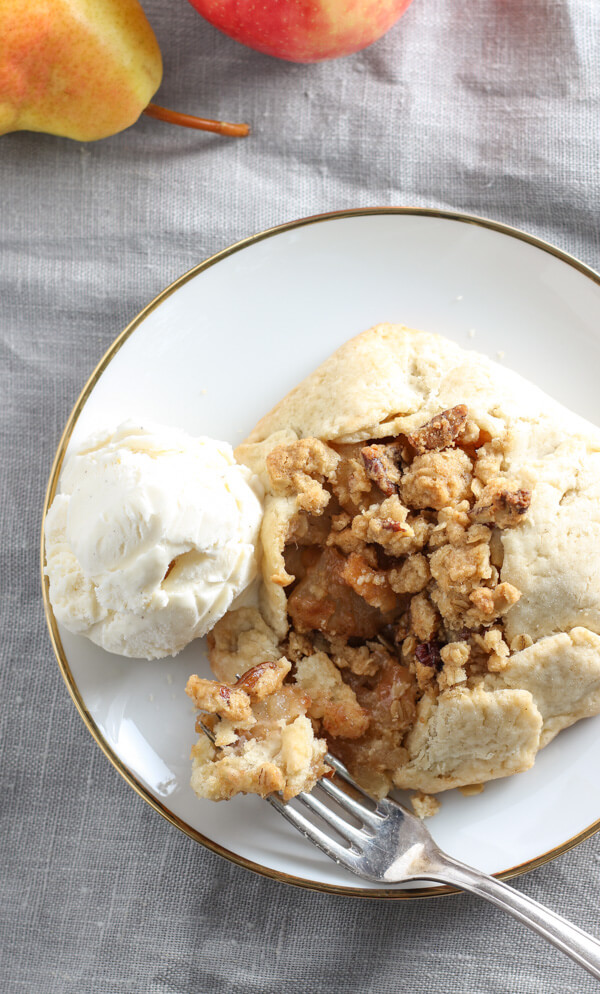 Apple & Pear Galettes with Pecan Streusel - Apples and pears harmonize with cinnamon, nutmeg, and brown sugar in a buttery, flaky galette crust that is topped off with a pecan streusel. (GF) | passmesometasty.com