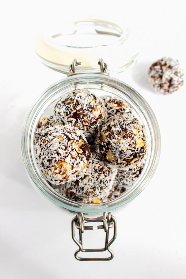 A mason jar filled with fruit and nut energy bites.
