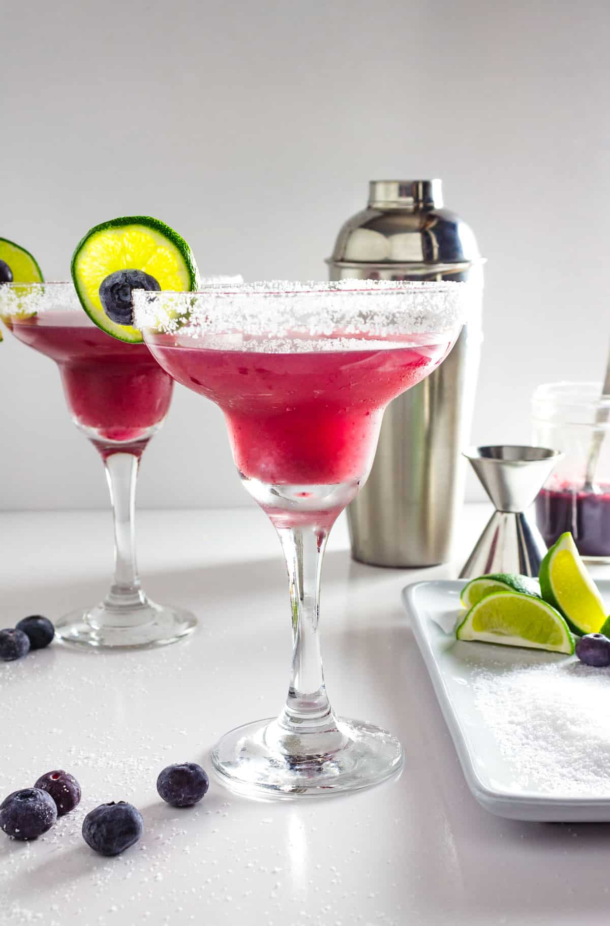 A table is set up for making blueberry margaritas.