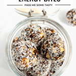 Fruit & nut energy bites are stored in a mason jar.