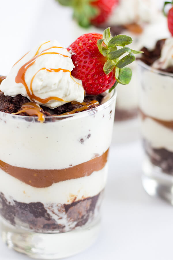 Salted Caramel Brownie Ice Cream Parfaits | Dessert | Gluten Free Recipe | Layers of warm brownie, ice cream, and salted caramel topped with homemade whipped cream and strawberries are what these dessert parfait dreams are made of. | passmesometasty.com