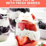 Layers of fresh berries and chia pudding in a small jar topped with coconut flakes.