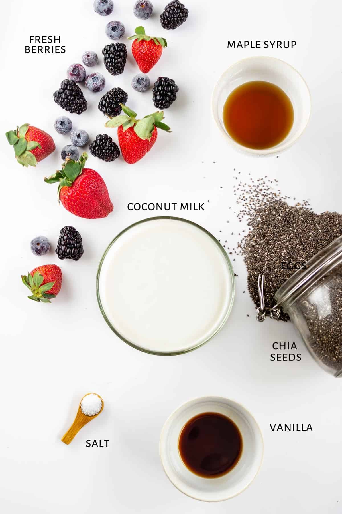 Ingredients for chia pudding parfaits are laid out on a countertop.