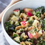 Picnic Perfect Kale Quinoa Salad - The PERFECT heart-healthy salad for picnics, BBQs, or travel! Quinoa, kale, toasted walnuts, juicy apples, and cranberries are tossed in a cider vinaigrette for a super tasty main dish or a delicious side dish. Naturally gluten-free and vegetarian. | passmesometasty.com
