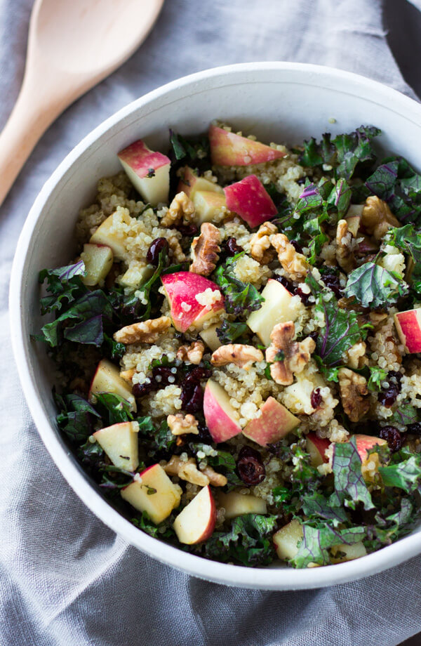Picnic Perfect Kale Quinoa Salad - The PERFECT heart-healthy salad for picnics, BBQs, or travel! Quinoa, kale, toasted walnuts, juicy apples, and cranberries are tossed in a cider vinaigrette for a super tasty main dish or a delicious side dish. Naturally gluten free and vegetarian. | passmesometasty.com