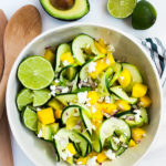 A beautiful salad of spiralized cucumbers, mango, avocado, and soft goat cheese with lime.