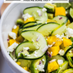 Spiralized cucumbers are tossed with chucnks of mango, avocado , and crumbles of soft goat cheese.