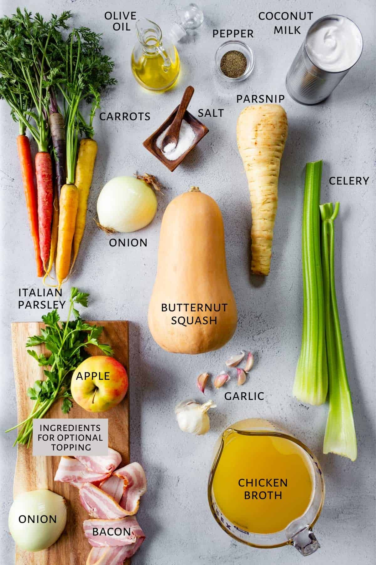 Ingredients for butternut squash soup are spread out on a counter.