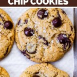 A sheet pan with freshly baked chocolate chip cookies.