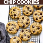 Chocolate chip cookies sitting on a cooling rack.