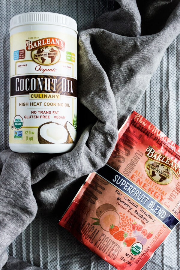 A close-up of two products used in the superfood morning scuffin recipe: Barlean's organic culinary coconut oil and Barlean's Superfruit Blend.