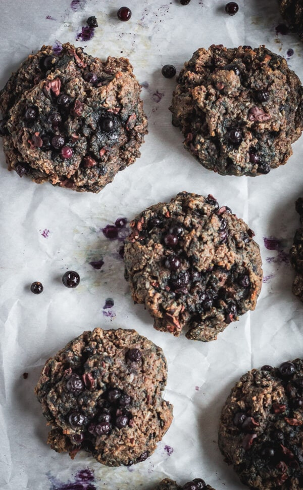 Freshly baked superfood morning scuffins resting on parchment paper.