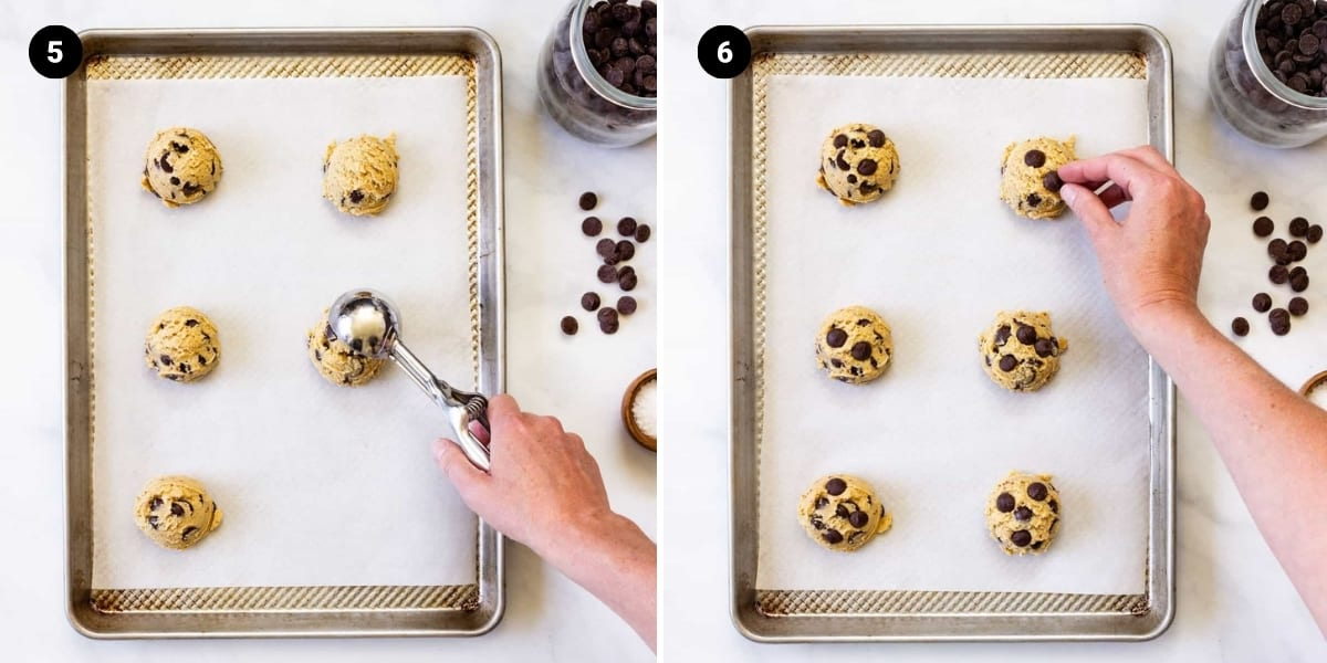 A scoop is used to place cookie dough mounds on a baking sheet. Chocolate chips are pressed into the top of each dough mound.