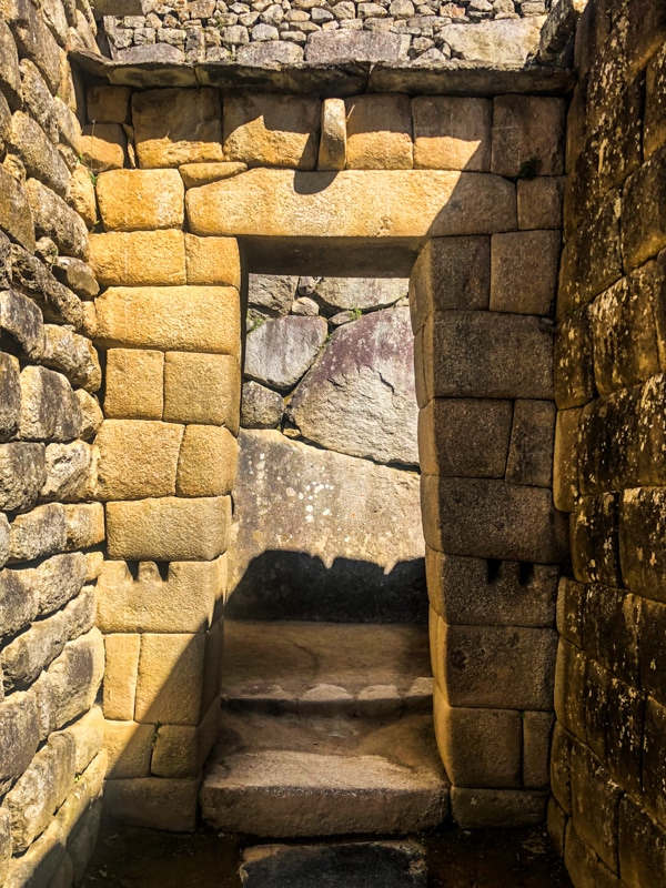 A stone doorway in the ancient Incan Machu Picchu ruins.