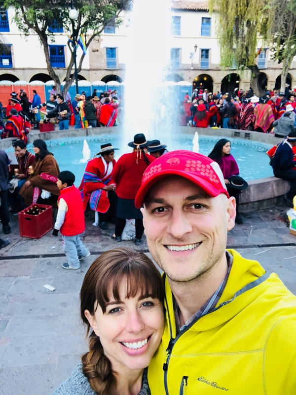 Shannon of Pass Me Some Tasty and her husband hanging out in a plaza in Cusco.