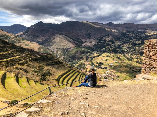 Shannon of Pass Me Some Tasty enjoying the view of the Peruvian countryside and Incan ruins from her high mountaintop view.