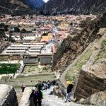 Walking up the steps of ancient Incan ruins at Ollantaytambo.