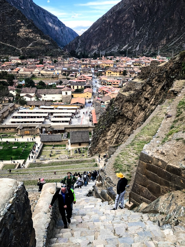 Walking up the steps of ancient Incan ruins at Ollantaytambo.