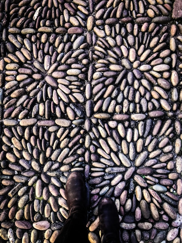 A beautiful floor pattern made out of river rocks in The Hotel Marqueses