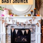 """A fireplace mantle decorated with a """"Welcome Little Pumpkin"""" banner and an assortment of painted mini pumpkins in silver, gold, and pink mixed with natural orange and white mini pumpkins."""