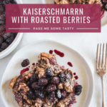 Two plates of Kaiserschmarrn topped with roasted Oregon Marionberries. A baking dish with roasted berries sits nearby.