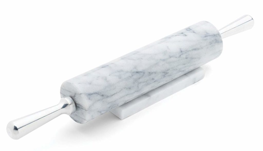A marble rolling pin with aluminum handles and a marble resting base.