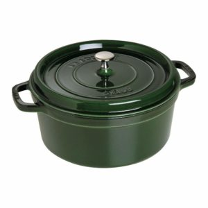 A green Staub Dutch oven with a nickel steel knob.