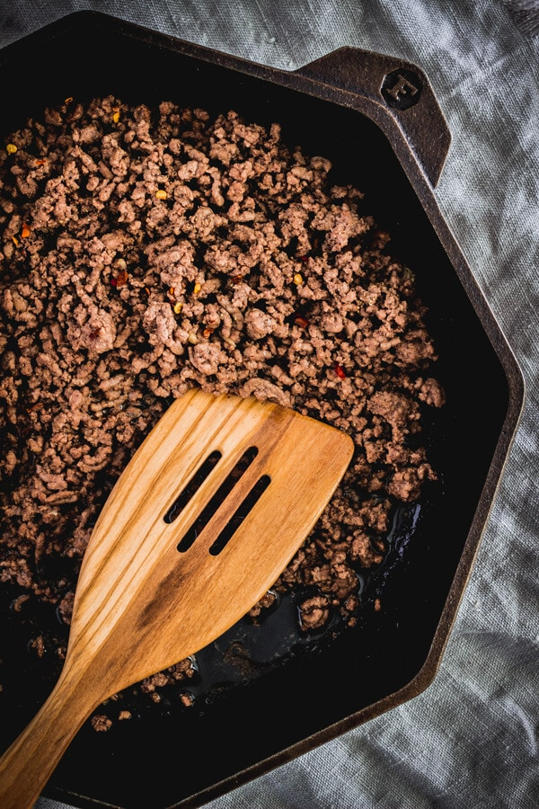 Lean ground beef cooked in a octagonal cast iron skillet.