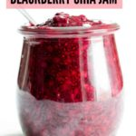 A small Weck jar of blackberry chia jam made with Oregon Marionberry blackberries. A spoon is dipped into the jar.