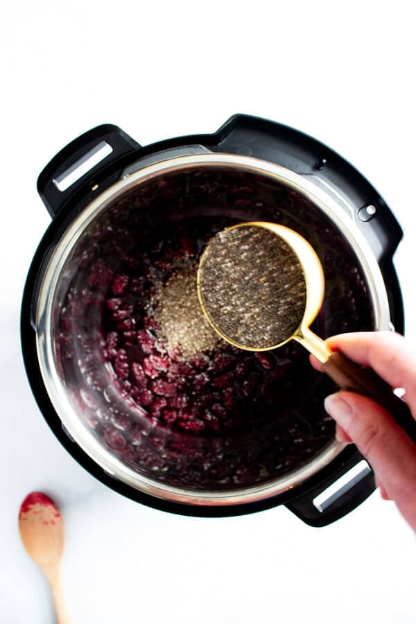 One-third cup of chia seeds are added to the cooked berries.