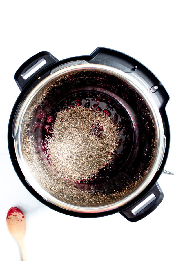 Chia seeds are added to the cooked marionberries.