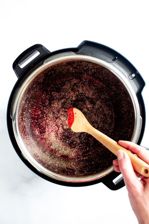 Stirring the chia seeds into the cooked marionberries.