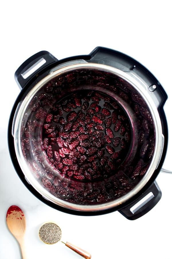 After pressure cooking for 1 minute, the frozen marionberries have turned into a juicy berry mixture.