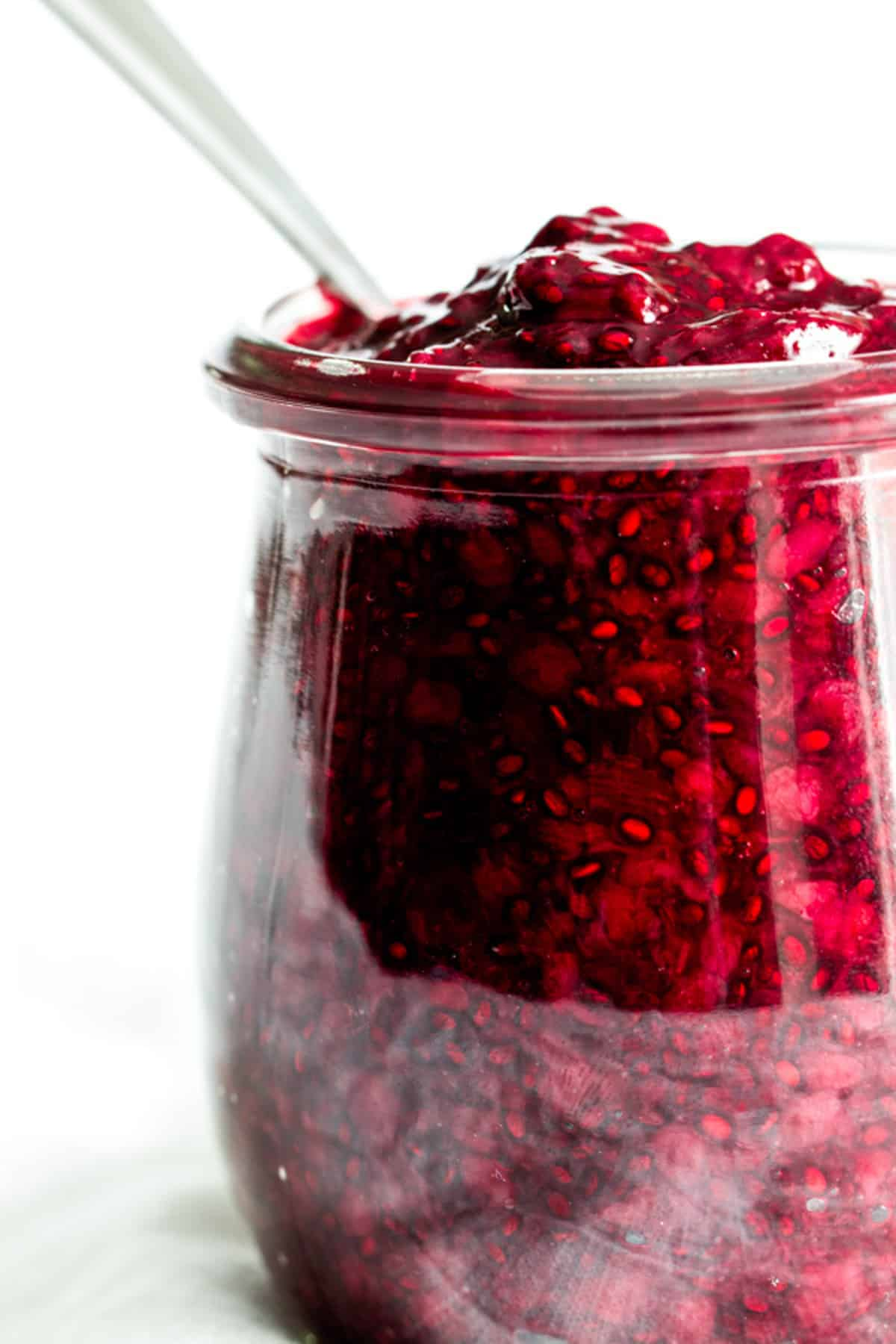 A close-up view of a jar of blackberry chia seed jam made with Oregon Marionberry blackberries.