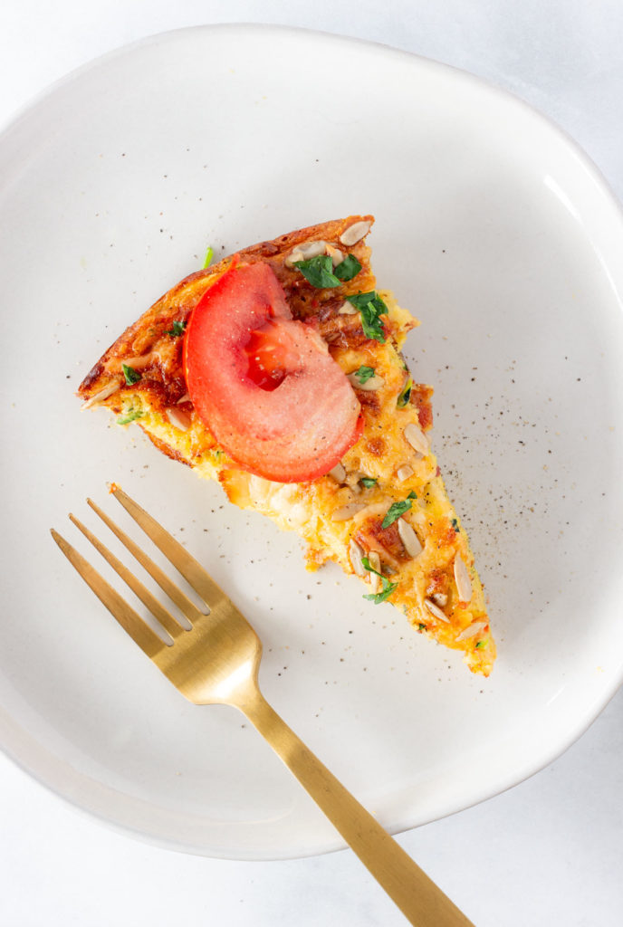 A slice of crustless zucchini bacon quiche.
