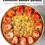 A beautiful gluten free crustless zucchini bacon quiche topped with sliced tomatoes and melted cheese.