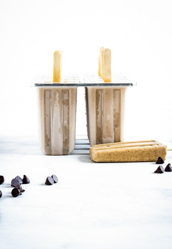 Chocolate chip cookie dough popsicles in a frozen popsicle mold ready to be eaten!