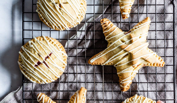 Gluten-Free Raspberry Hand Pies with White Chocolate Drizzle