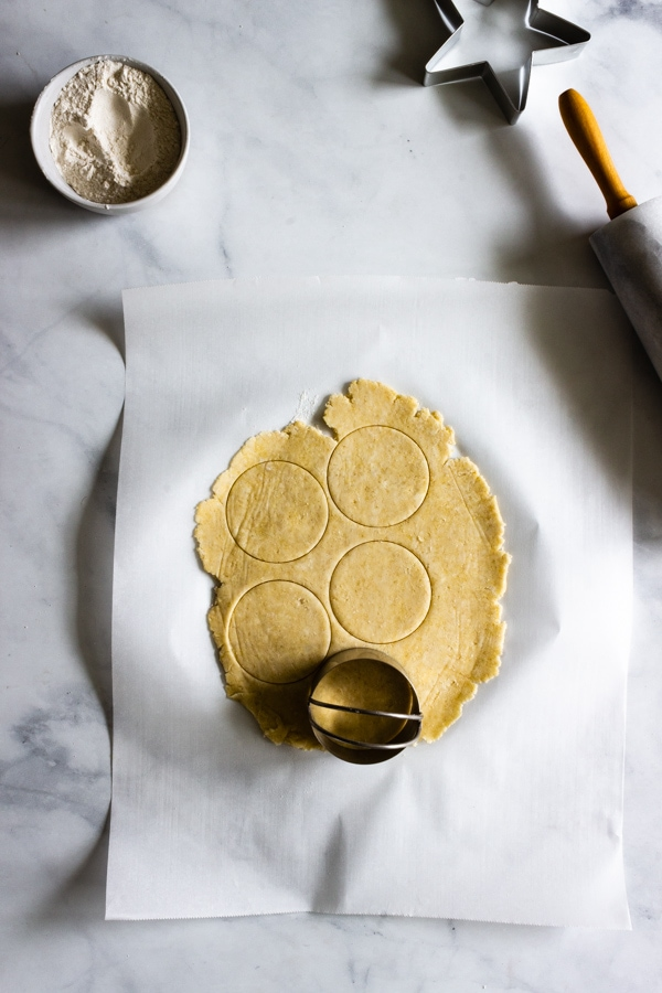 Round circles are cut in the hand pie dough.