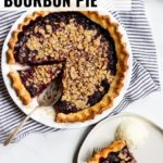 A blackberry bourbon pie with a crumble topping as been sliced and served à la mode.