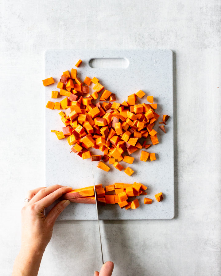 Once the sweet potato has been cut into strips, begin slicing along the strips every ½ inch resulting in diced sweet potato.