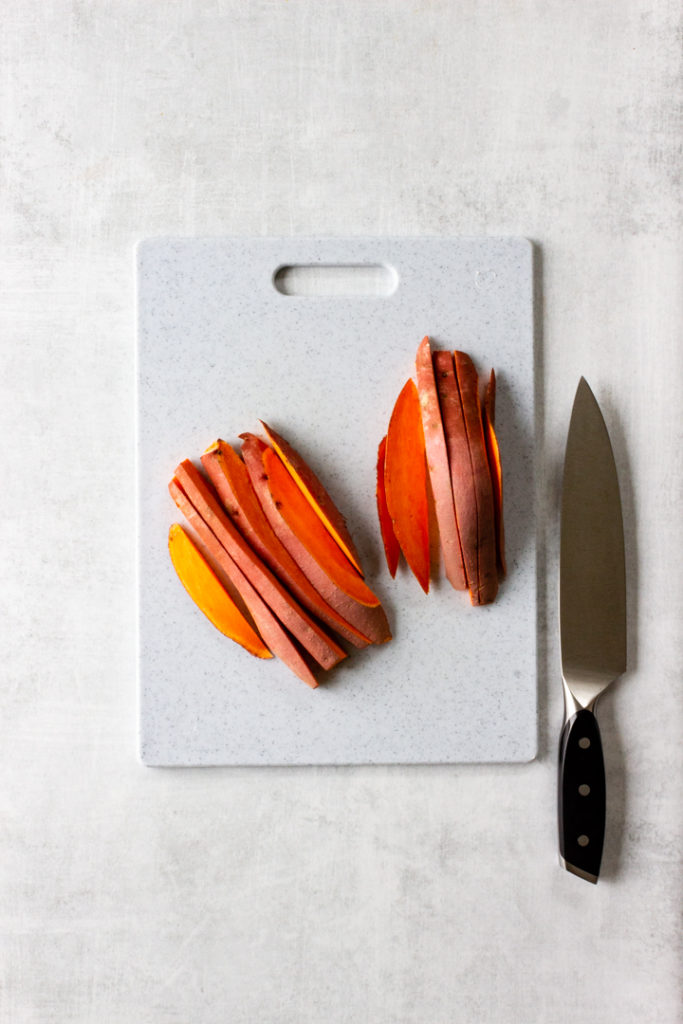 The sweet potato is cut in slices lengthwise about a 1/2 inch thick.