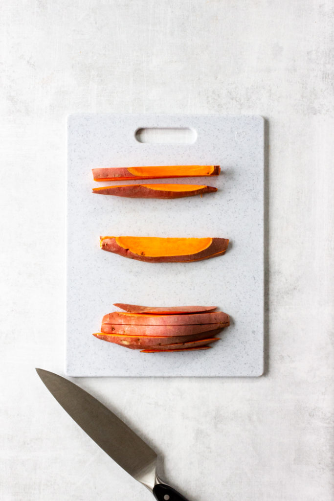 Lay the sweet potato slices on its side and slice again into 1/2 inch slices.