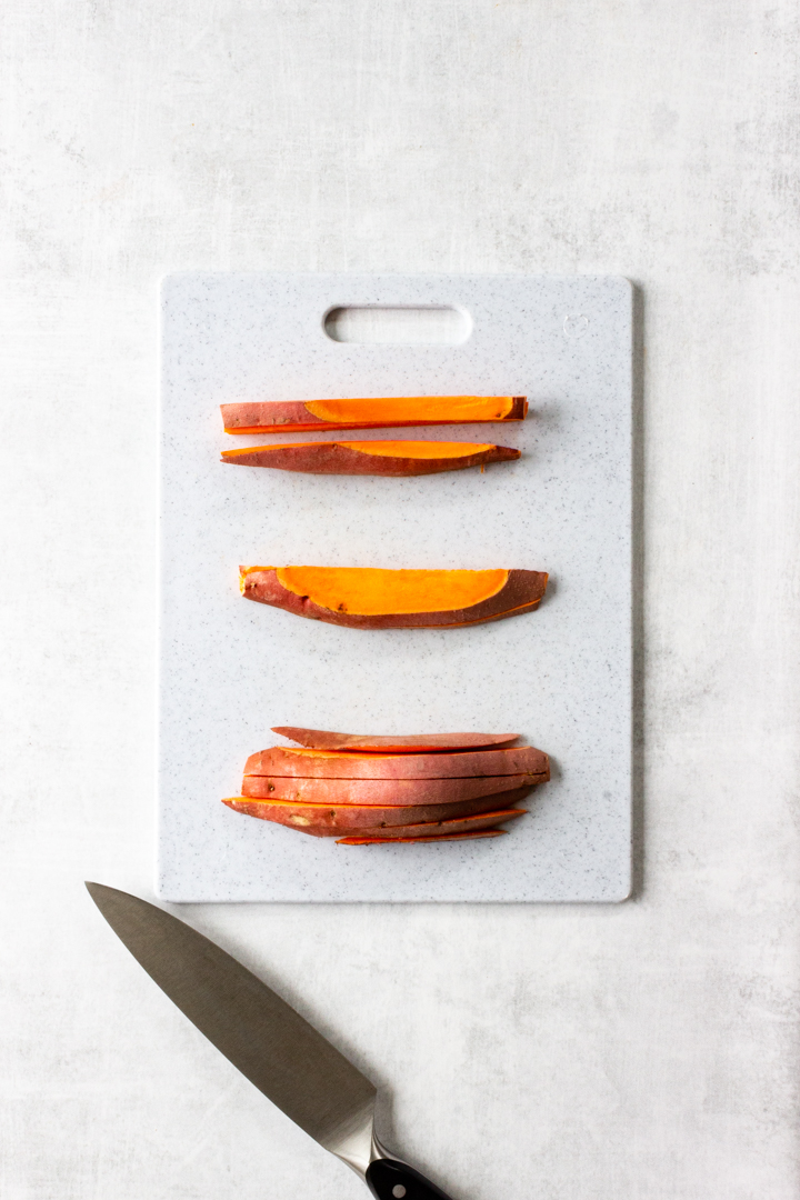 Lay the sweet potato slices on its side and slice again into ½ inch slices.